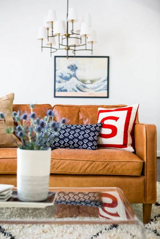 brown-leather-couch-red-blue-pillows