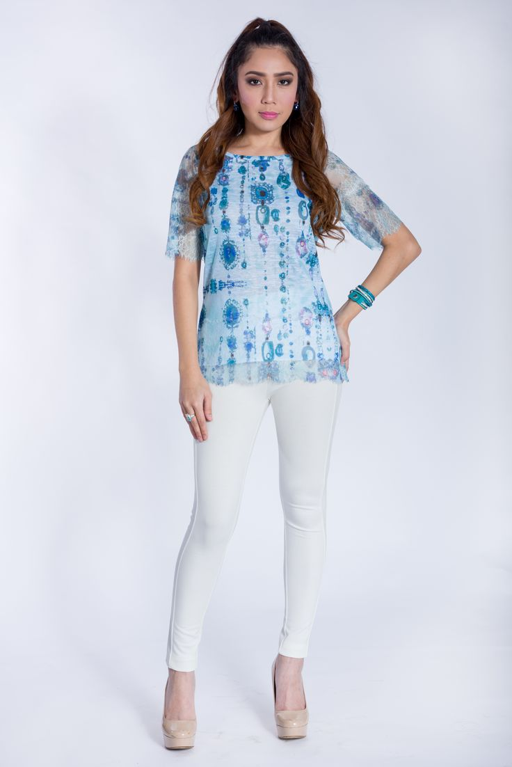 Leo Ugo Paris. Colorful knit pullover with lace bottom and elbow length sleeves.