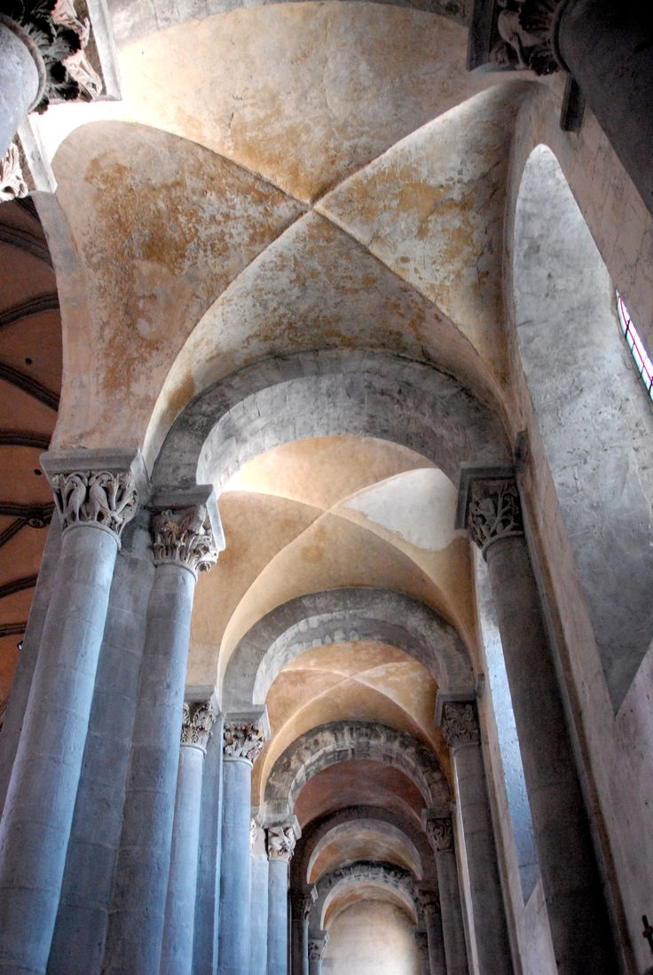 The aisle of the Abbey Church at Mozac has a groin vault supported on transverse arches.