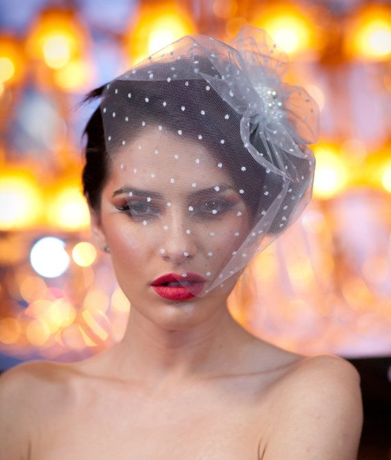 I really love the idea of the dots. Not so crazy about the pearls holding it together though. Fake pearls make me twitch.