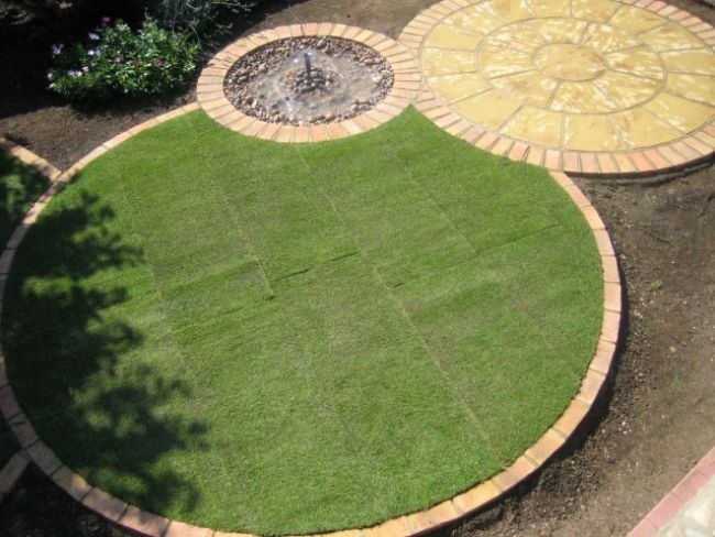 Circular lawn edging as part of round garden theme.