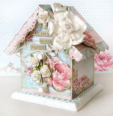 so pretty...do an actual bird house found at Michaels or maybe Kaiser Craft has some chipboard one.  You can cover it with vintage scrapbook paper make some paper flowers.  Eyelet may be used or Martha Steward has an eyelet punch with is beautiful.  Rickrack, buttons, and lace would be pretty, too.