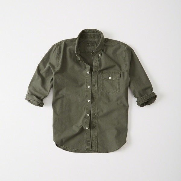 Abercrombie & Fitch Garment Dye Oxford Shirt (68500 IQD) ❤ liked on Polyvore featuring men's fashion, men's clothing, men's shirts, men's casual shirts, olive, men's curved hem t shirt, mens olive green shirt and mens oxford shirts
