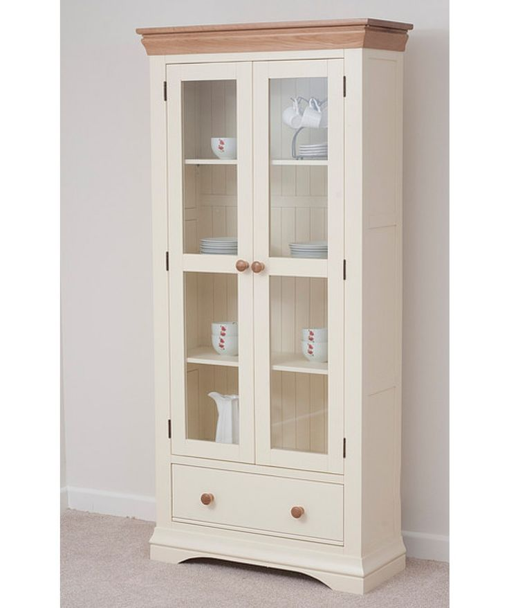 Country Cottage Natural Oak and Painted #DisplayCabinet offers an ample wide space with four wide shelves and a dovetail drawer. It is an ideal furniture for your #room.