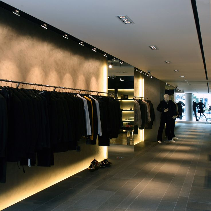 "HJL Studio - J. Roseroco New York Chungdam Flagship (2007) Clothing displayed along the elevated ""catwalk"" path."