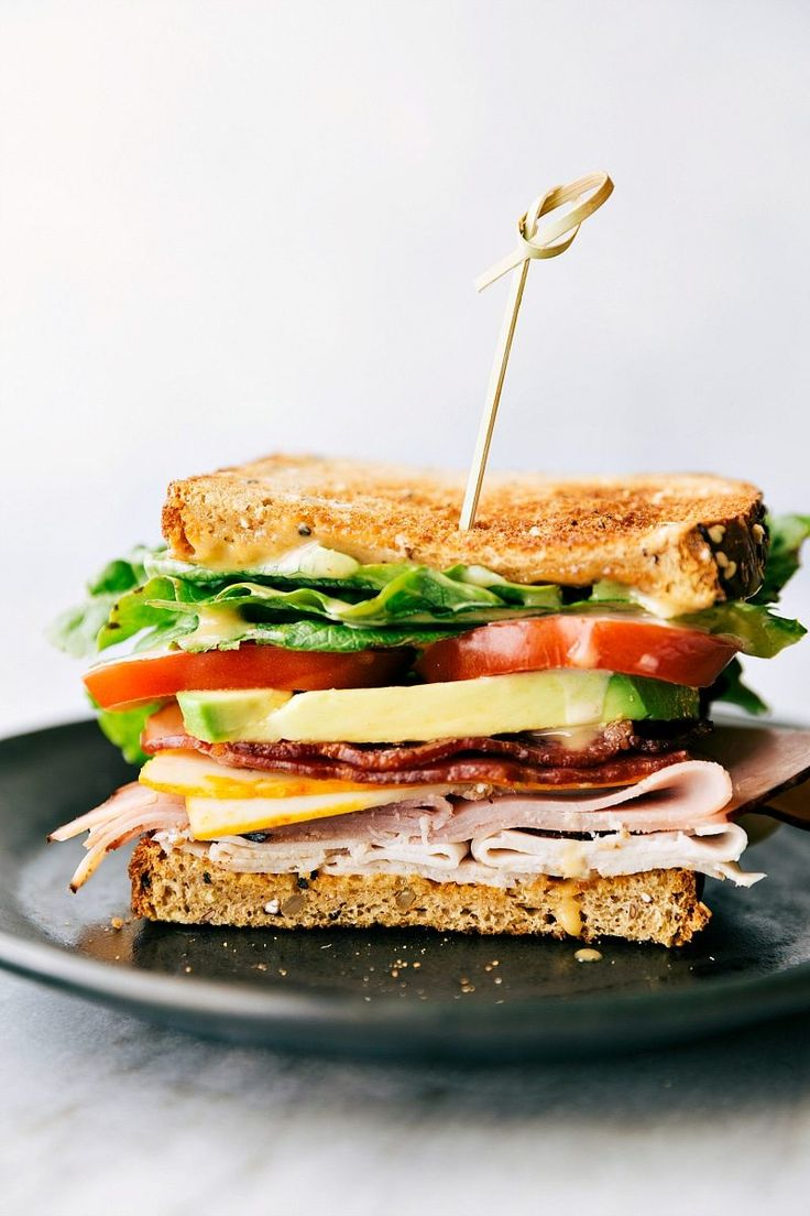 Honey Bacon Club Sandwich -- toasted bread, crisp fresh veggies, smoked turkey, honey ham, center-cut bacon, muenster cheese, and a honey mustard spread!