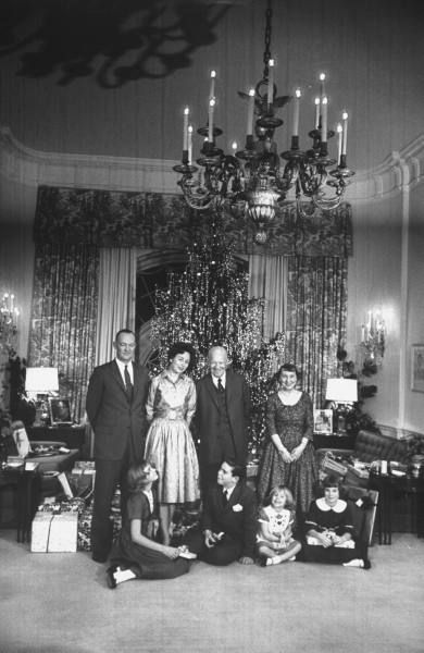 Mamie and Dwight Eisenhower with Family celebrating Christmas at the White House, 1960.