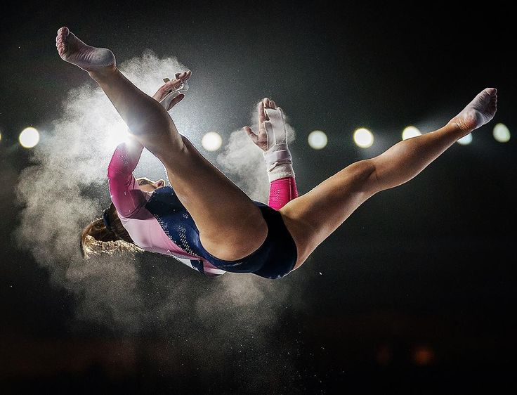 Amy Tinkler of Great Britain hands appear to be smoking as chalk flies off them during the World Gymnastics Championships. #montreal#MTL2017GYM #sonya9 #a9 #sports#gymnastics #flip #flying #goingforold