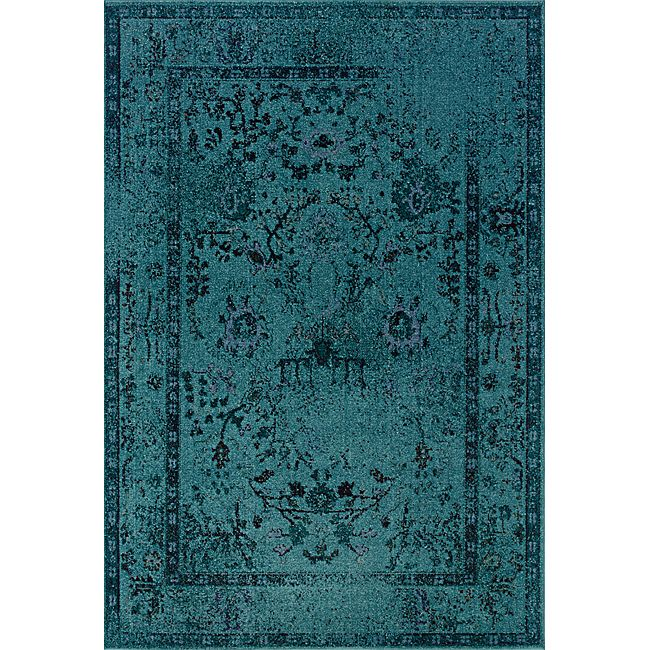 One of today's hottest trends, the over-dyed look, is replicated here in washed shades of teal and grey. Encompassing the best of both worlds this rug offers high style, affordability and ease of care.