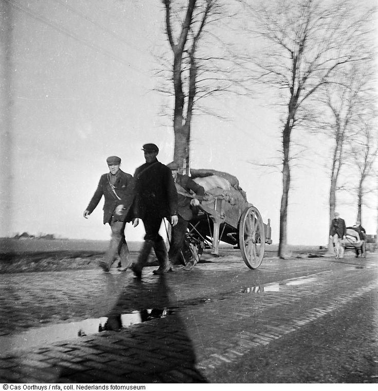 1944 - 1945. Men with hand carts full of food on a country road near Amsterdam. During the Winter of 1944-1945 Dutch rail workers went on strike to stop the Germans, who then punished them by putting a hold on all maritime transport. This cut off all food and fuel delivery. More than 20,000 people lost their lives in Amsterdam and the western part of the Netherlands during the winter of 1944-1945. Photo Boris Kowadlo #amsterdam #wordwar2