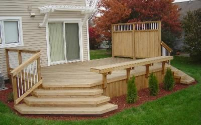 Great small deck with wide stairs to yard - needs to be stained, and the pergola needs to be larger to make it more pleasing to look at.