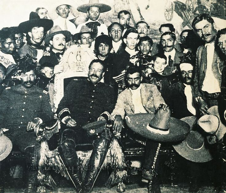 Pancho Villa on presidential chair during Revolution of 1914 in National Palace in Mexico City, Zapata is at left, Mexico, 20th century