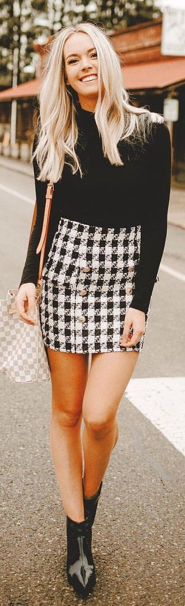 #winter #outfits black crew-neck long-sleeved shirt with houndstooth fitted miniskirt. Pic by @karlierae.