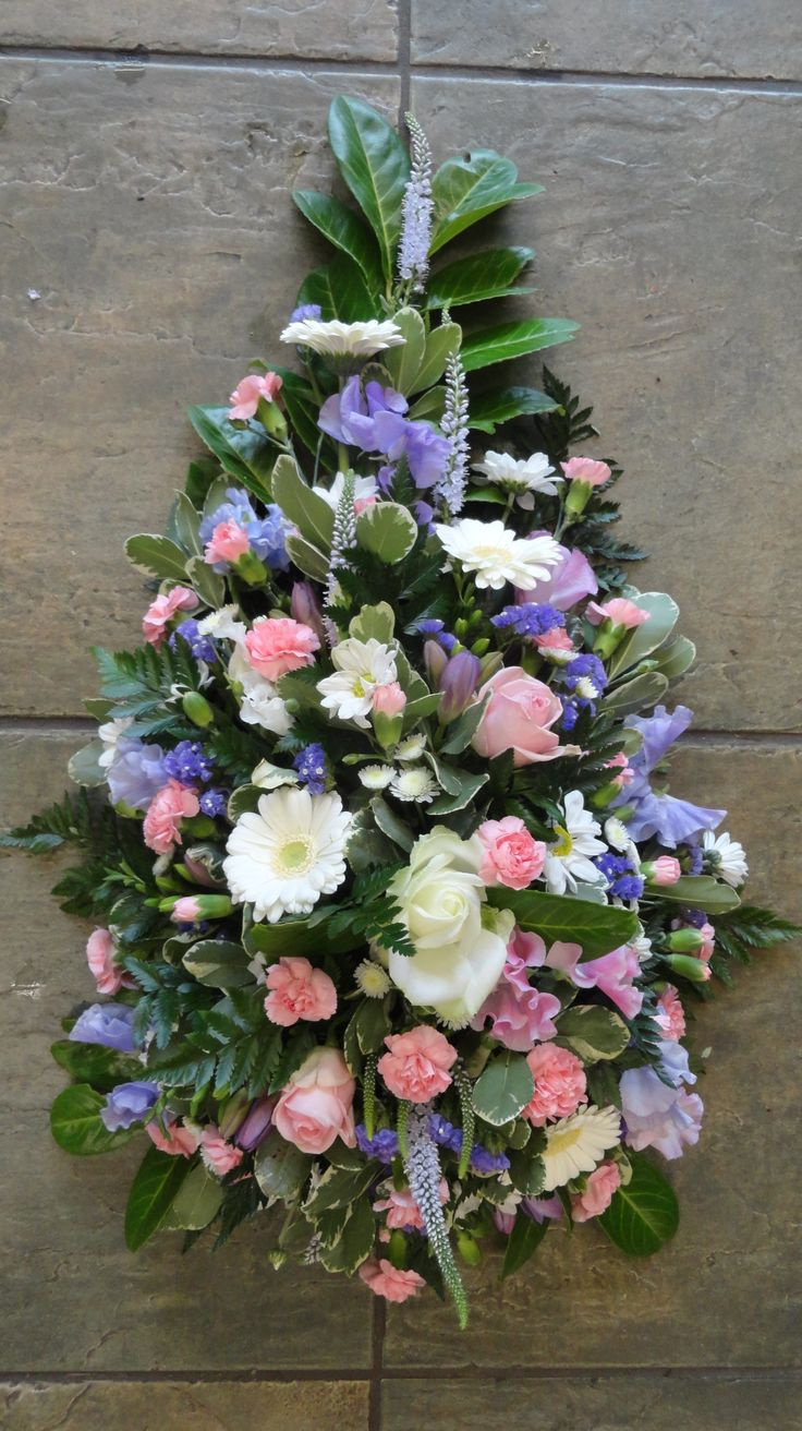 Single-ended spray in pinks, whites and lilacs.