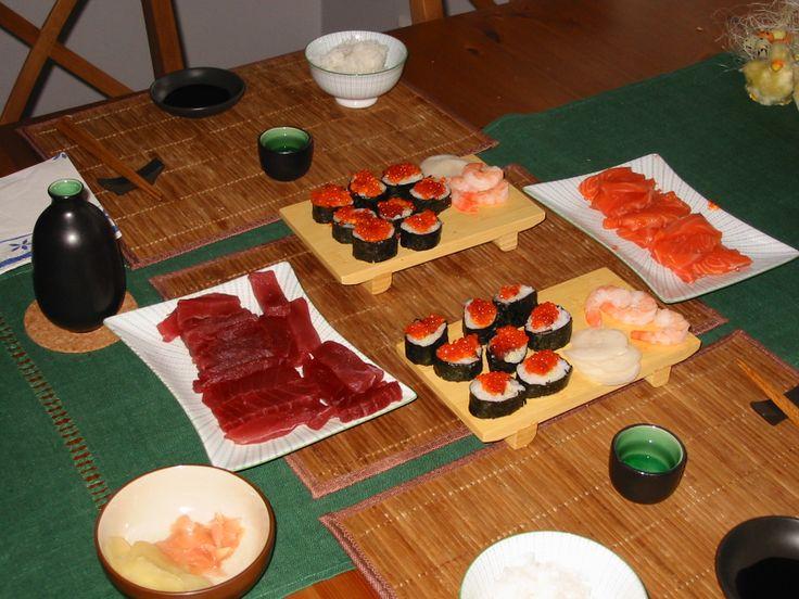 Sushi and sashimi: tuna, salmon, king prawns, salmon roe, seaweed rolls, pickled ginger, wasabi, jasmine rice, sake.