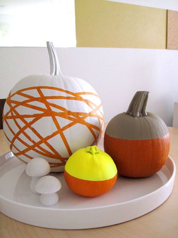 pumpkin centerpiece- part 2- PoP Pumpkins!-I love this! So fall, but not traditional. This is the original post with tutorial. Modern Pumpkin painting.