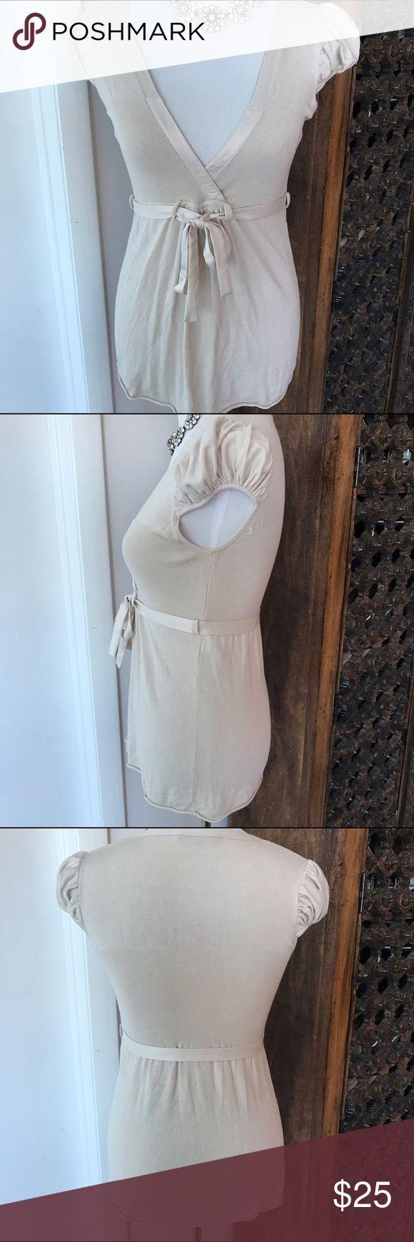 Kookai Knit Cream cap sleeve Top Kookai cream cap sleeve top. Empire waist with tie belt. European Size 1 = S Kookai Tops