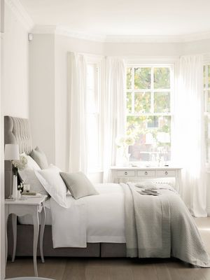 i love....the bedskirt, the bright windows with whispy curtains, the structured bed that I want to jump in...