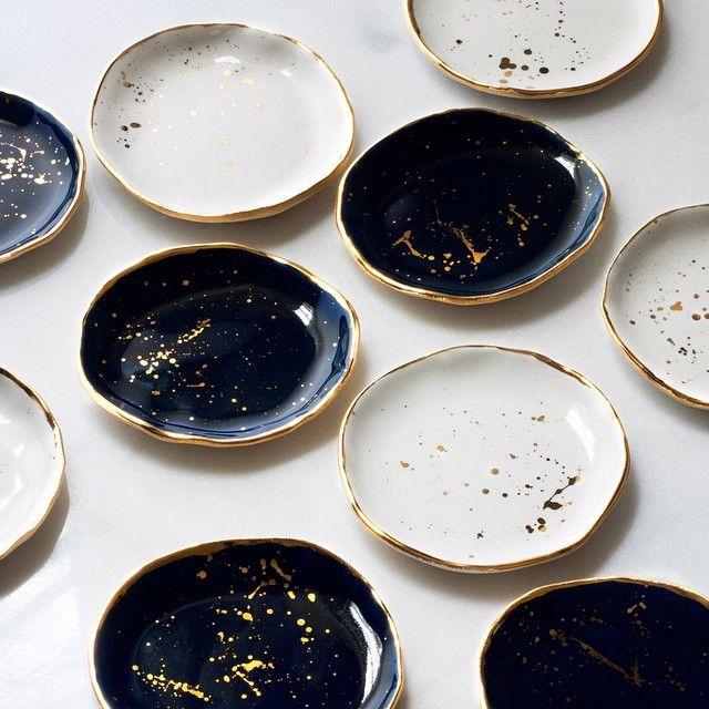 gold rimmed navy & white ceramics