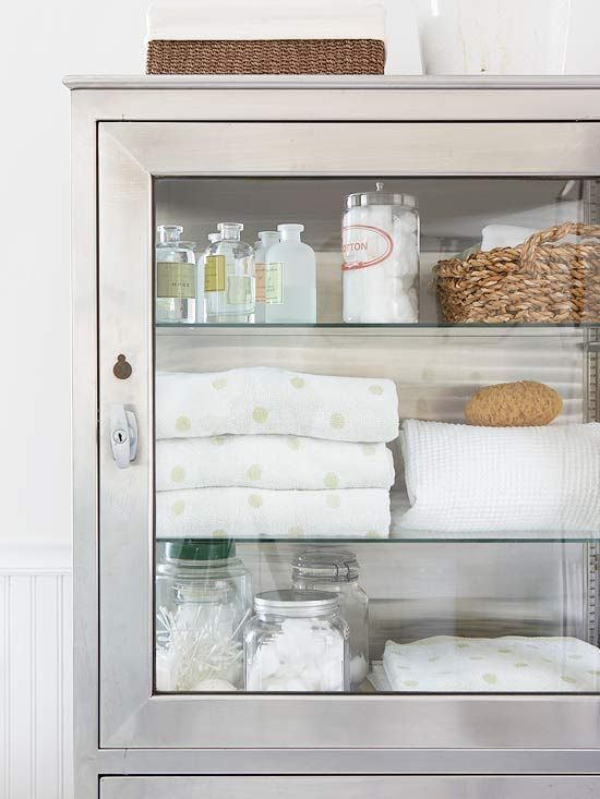 Enlist New Storage If your bath lacks a closet, repurpose a cabinet or dresser to keep extra linens and supplies on hand. Bath oils and bulk items, such as cotton swabs, look pretty in glass jars -- plus it's easy to know when to restock./