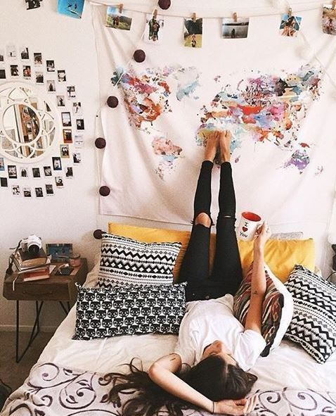 hanging a tapestry is an easy way to decorate your dorm room on a budget