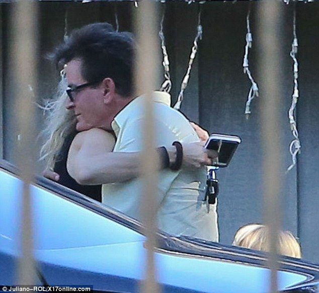 Before Sheen and Mueller's embrace, Sheen had been removed from Hennessey's Tavern in Dana...