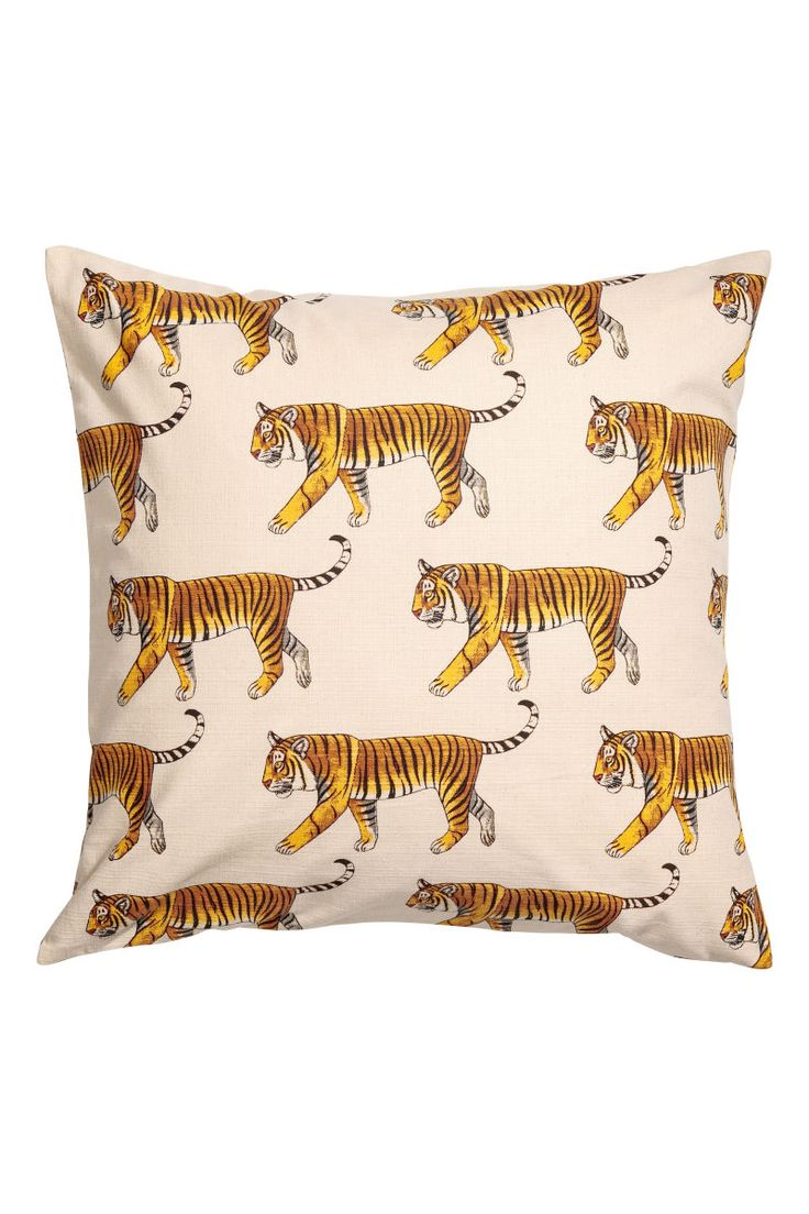 Natural white/tigers. CONSCIOUS. Cushion cover in organic slub-weave cotton fabric with a printed pattern. Concealed zip.