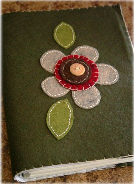 felt covered book- great journal cover or make one for those paper backs, using a stretch knit for the inside flaps