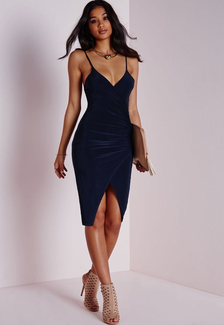 Ensure you look bodycon-tagious in this navy bodycon beaut. With seriously seductive ruched gathering to the side in a slinky fabric this V neckline dress with asymmetric hem will give you a knockout silhouette. Team with strappy nude heels...