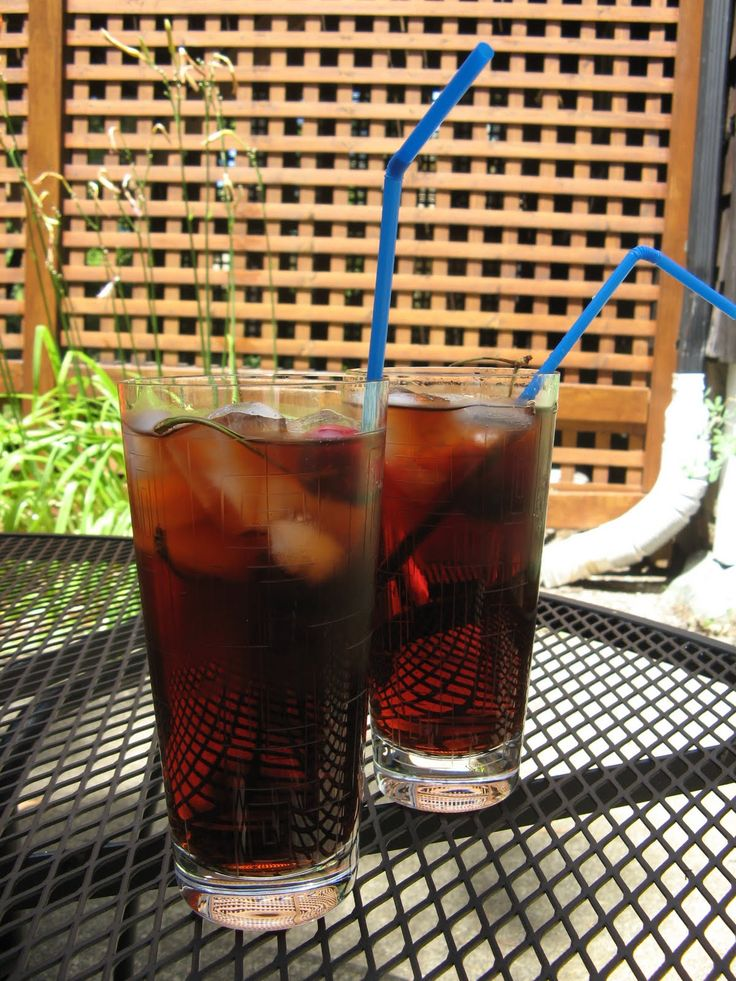 Fill glass halfway with black cherry soda. Add 2 oz vanilla vodka Add black cherry seltzer almost to the top Slice lime and squeeze, add two cherries Add ice cubes and stir