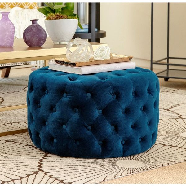 Freshen up your home decor with the Ella blue tufted round velvet ottoman. Designed by Abbyson Living, this engaging furniture will brighten any space. Materials: Hardwood frame, velvet fabric, plasti
