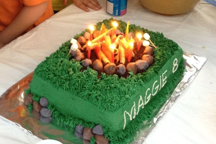 """Awesome cake made to look like a campfire. Rocks are fondant, and """"flames"""" are melted hard candies. Perfect for a summer birthday or Boy Scout party!"""