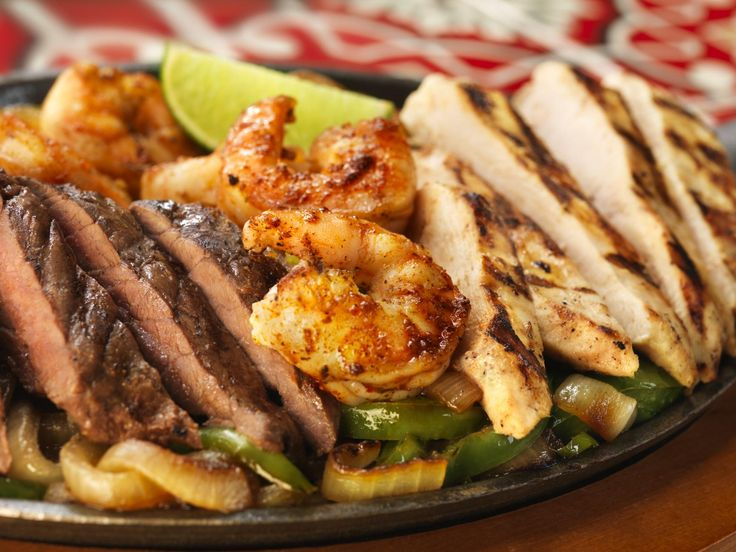 Fajita Trio: Grilled Steak, chicken and spicy garlic and lime grilled ...