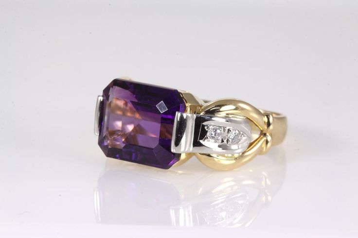 Amethyst and Diamond ring with Emerald cut Amethyst of 5.23ct and Diamonds totalling 0.10cts. 18ct yellow gold and Platinum, ring size M1/2 - can only be resized up and down by a maximum of 3 sizes. (Pre-owned)