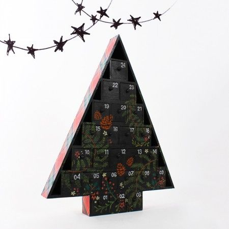 Decorate a wooden advent calendar with plaid Décopatch paper and chalkboard paint. You can draw different chalk or pastel designs on the calendar surface every year!