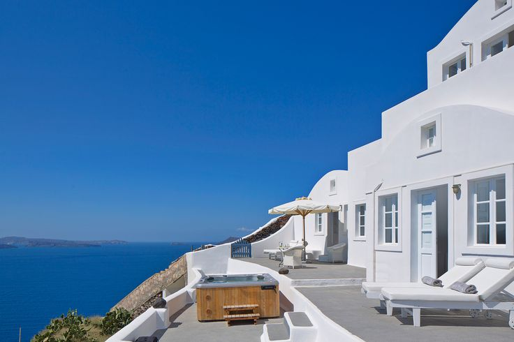 Relax in your Jacuzzi at the Canaves Oia Villa and take in the calm of the Aegean sea