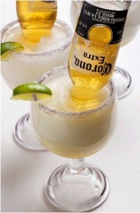 Mexican Bulldog Margarita  1 oz of tequila  Lime margarita mix  1 Corona  Mix and put in your large glass. Then take a bottle of Corona, open it and flip it upside down into the margarita mix. Let the beer bottle stay flipped upside down because when you drink the beer will slowly poor out into your Margarita. I've heard these are amazing, and I want to try one!