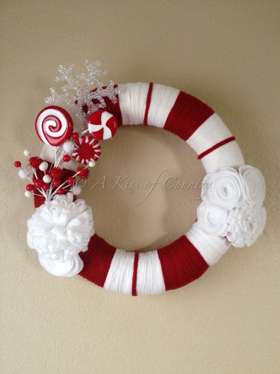 Christmas wreath candy cane wreath by AKissofcountry on Etsy, $50.00... Or you could make it yourself for $10 and it's the easiest thing ever.