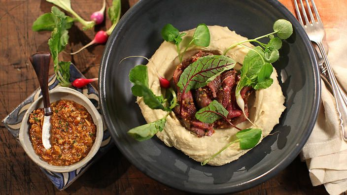 If you think your hummus needs a little oomph, take @shanedelia's advice and add roasted cauliflower! Here he's served the dip with wagyu beef and sweet-nutty amlou dressing. Shane Delia's Moorish Spice Journey starts 8pm Thursday 15 October on SBS.
