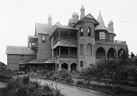 Camelot House at Kirkham, suburb of the Macarthur Region of Sydney in 1900.Camelot was designed by the Canadian-born architect John Horbury Hunt for James White,New South Wales politician and great-uncle of Patrick White.It was built c.a. 1888,on the site of John Oxley's old Kirkham Mill and partly on its foundations.It was originally called Kirkham.The name was changed to Camelot by a new owner, Frances Faithful-Anderson in 1900.