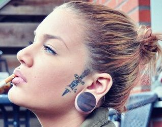 small face tattoos - Google Search