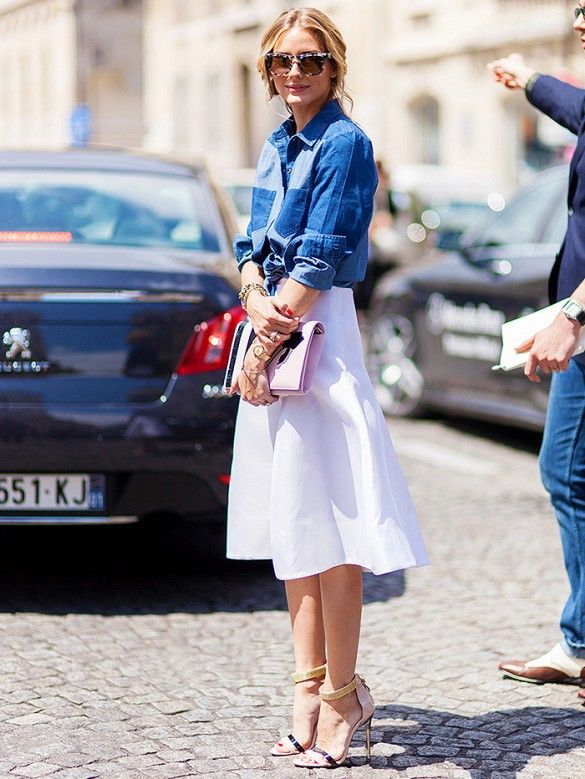 Olivia Palermo in a denim shirt and white knee-length skirt