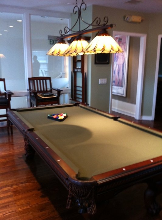 The upstairs pool table at the Kennedy's Club in Darien, CT......Love the light fixture and the felt color for the pool table.