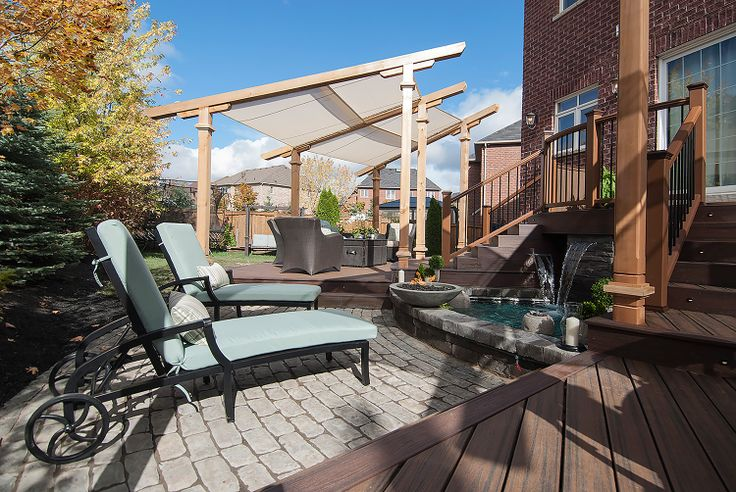 """A laid-back lounge zone overlooking the fire & water feature on """"Decked Out"""" project """"The Semicircle Deck"""".  Deck Design by Paul Lafrance Design."""