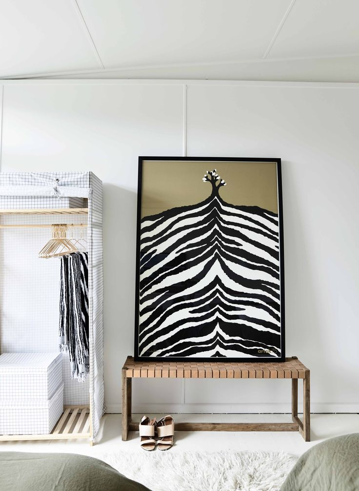 This eye catching Artek 75th Anniversary poster, standing against Haymes Organic 1, adds a real wow factor to the guest bedroom of @simonehaag's #anglershack  Check out @lukefurniture to get this look.  Photography by @derek_swalwell and styling by @simonehaag.  #haymespaint #homeinspo #australiandesign #interiordesign #colour