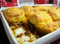 Hungry Jack Casserole...   1 lb Ground Beef, 3/4 c. Barbecue Sauce,  16 oz Pork & Beans,  2 T. Brown Sugar,  1 tsp Salt 1 T. Instant Minced Onion 6-9 Hungry Jack Flakey Biscuits or Pillsbury Grands, 1 c. shredded Cheddar...  Preheat oven to 375 degrees. Brown ground beef; Drain. Add next 5 ingredients; Heat until bubbly. Pour into 2 quart casserole dish. Peel biscuits in half; Place on top. Sprinkle with cheese. Bake 25-30 min. Serve. Try with chopped hotdogs.