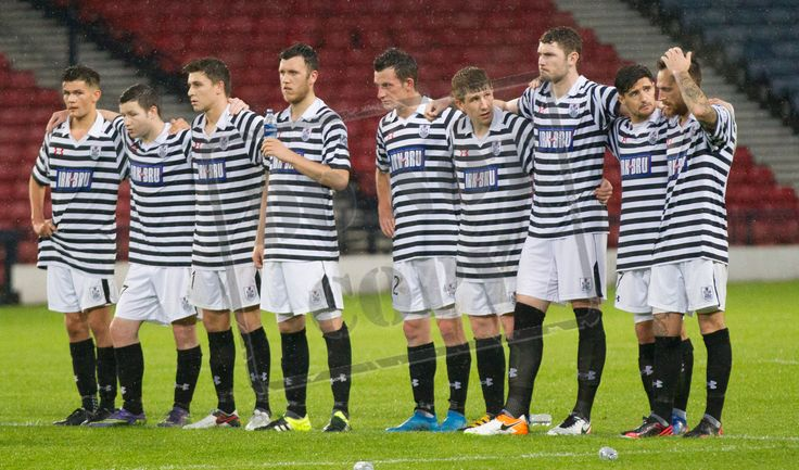 Queen's Park's players during the penalty shoot out at the end of the Betfred Cup game between Queen's Park and Airdrieonians.