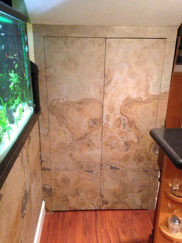Hidden doors covered with slate-lite veneer.