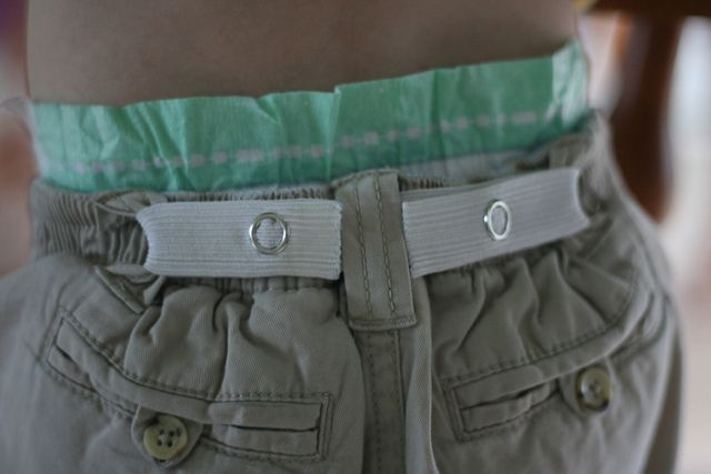 the DIY toddler belt! It's just two snaps on a length of elastic. So easy.  This is a great idea for my 4yr old. Be hates belts!  Only thing I'd change is I would put the elastic on the inside of the pants and maybe cover the elastic with a fun cotton print!!