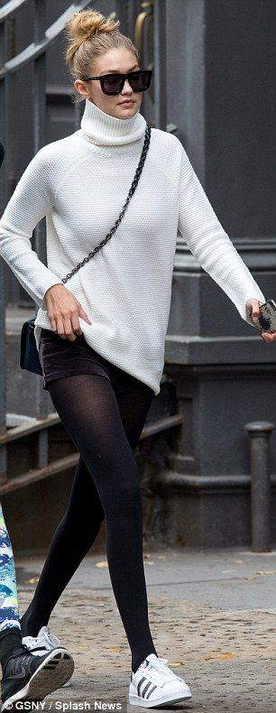 A fun look: Gigi had on a beige turtleneck sweater with black stockings…